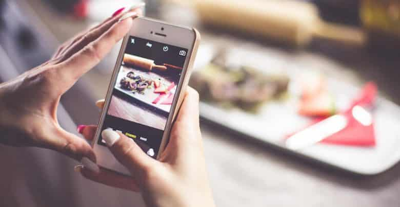 girl taking a photo of her food with iphone picjumbo com 1