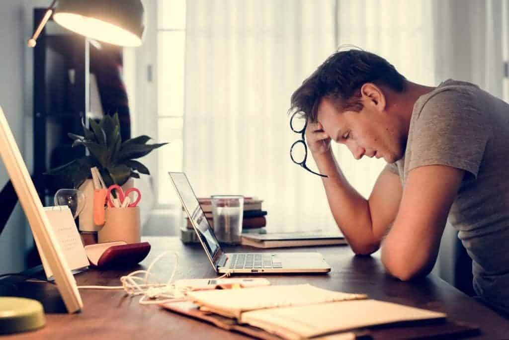man stressed while working on laptop GDPR - RGPD